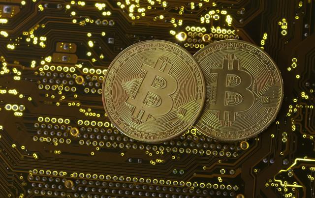 Đồng Bitcoin lại lập kỷ lục mới về giá, hơn 6.500 USD/bitcoin - Ảnh 1.